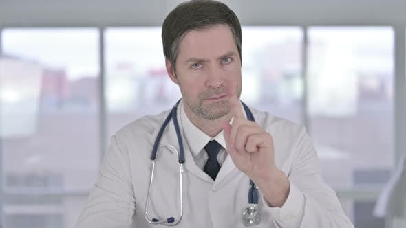 Thumbnail for Portrait of Middle Aged Doctor Saying No with Finger Sign
