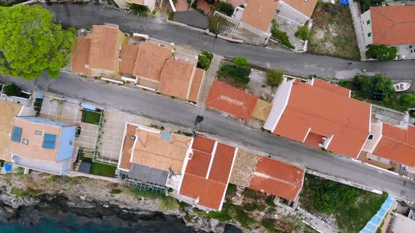 Top Down Aerial View, Flight Over the Rooftops of a Mediterranean Tourist Town