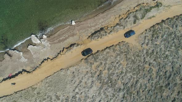 Top View of Two Cars Driving Alone Sea Coast Line in Lemnos, Greece