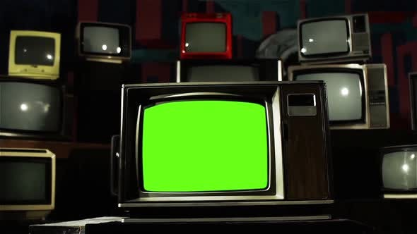 Vintage TV with Green Screen and Retro TV Stack Installation. Dolly In.