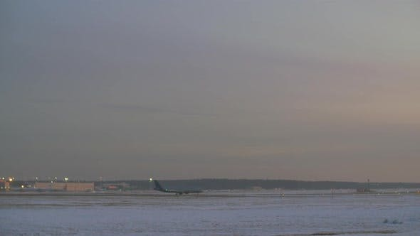 Thumbnail for Airplane Taking Off. Airport View in Winter Evening