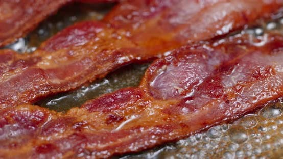 Thumbnail for Fry bacon in pan in kitchen