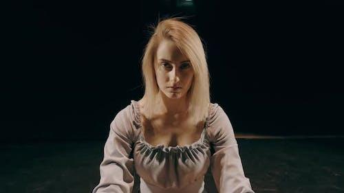 Serious Woman Portrait on Dark Background. Serious Looking Young Woman Portrait. Portrait
