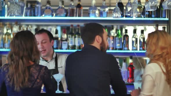Thumbnail for Group of Friends Relaxing on Party in Bar, Talking with Bartender