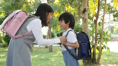 Cute Asian Children Going To The School Outdoors
