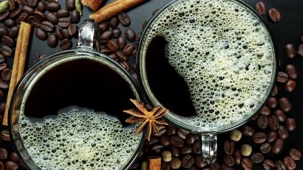 Thumbnail for Rotating Two Cups with Coffee on Coffee Beans and Carica Sticks