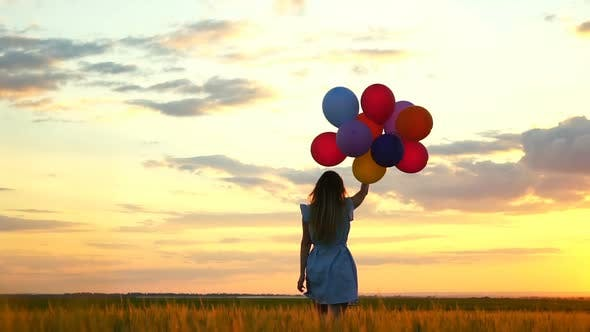 Thumbnail for Happy Woman with Balloons Running in the Wheat Field at Sunset