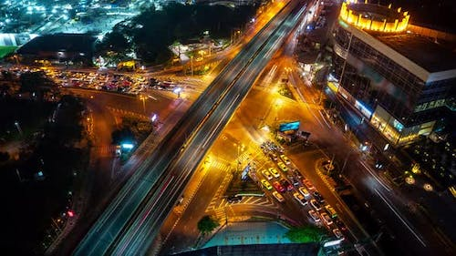 Time lapse of busy highway road junction in metropolis city center at night