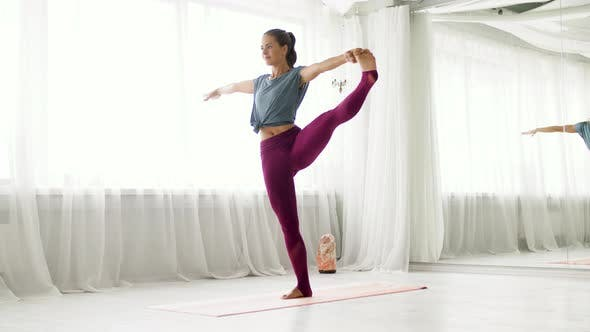 Thumbnail for Woman Doing Yoga Hand-to-big-toe Pose at Studio