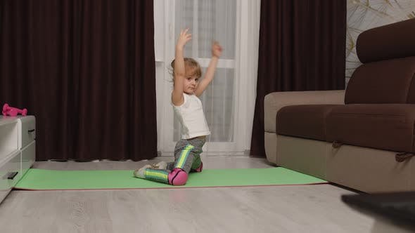 Thumbnail for Girl Kid Girl Doing Gymnastics Stretching Workout at Home Watching Online Lessons on Laptop Pc