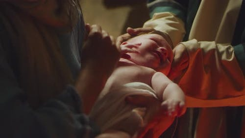 Mary and Joseph Comforting Crying Baby Jesus