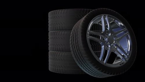 4 car wheels on black background. Car concept animation with wheels