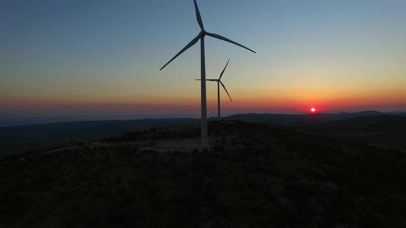 Thumbnail for Flying over windmills at dusk