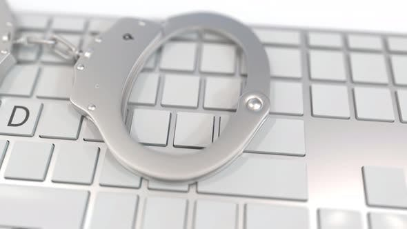 Thumbnail for Handcuffs on Keyboard with FRAUD Text on Keys