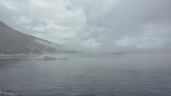 Thumbnail for Mountains and Ocean Waters By the Shore Covered By Thick Fog