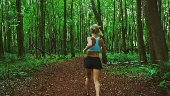 Thumbnail for Woman Running in the Forest