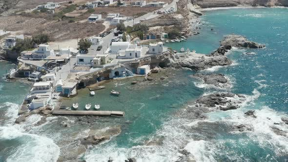 Wide Establishing Shot of Greek Fishing Village Build Right By the Ocean with Beautiful Turquoise