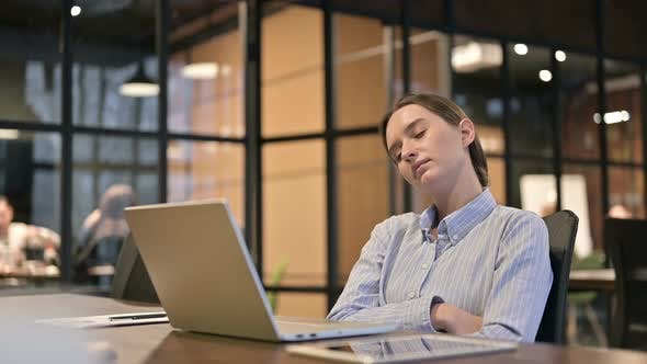 Thumbnail for Tired Young Woman Sleeping at Work