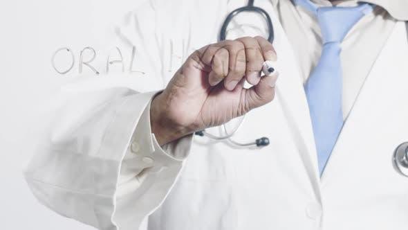 Asian Doctor Writes Oral Hygene