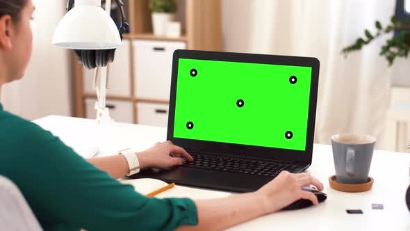 Thumbnail for Woman with with Green Screen on Laptop at Home