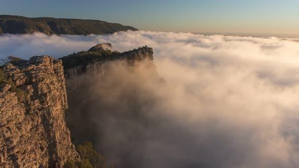 4K Timelapse of moving fog at golden hour at The Pinnacle, Grampians National Park, Australia