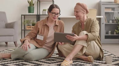 Woman with Oncology Talking to Social Worker at Home