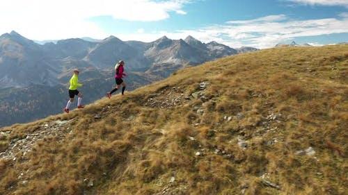 Aerial View Trail Runners Running on Mountain Ridge