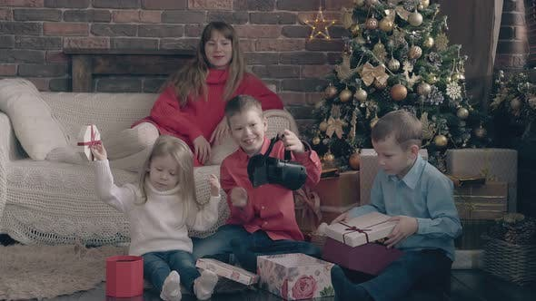 Thumbnail for Happy Children Open Christmas Gift Boxes Lady Watches