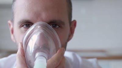 Inhalation at Home. Man Is Having Inhalation at Home