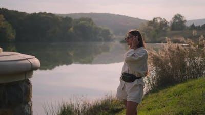 Woman and Peaceful Lake at Sunset