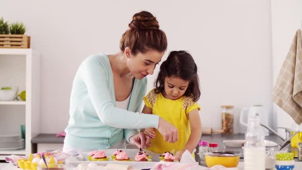 Thumbnail for Mother and Daughter Cooking Cupcakes at Home 17