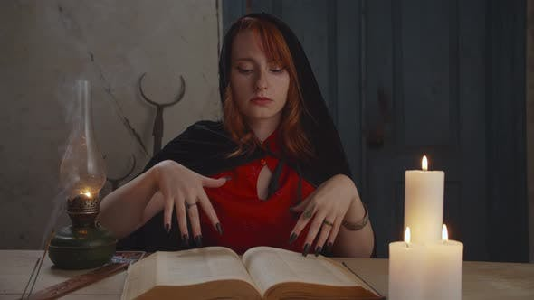Portrait of Mysterious Sorceress with Magic Book