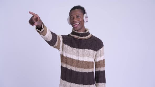 Thumbnail for Young Happy African Man Pointing Finger Ready for Winter