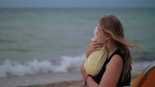 Mum with Baby Looking the Sea