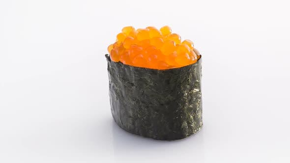 Spinning Nori Sushi with Red Caviar Isolated on the White Background.