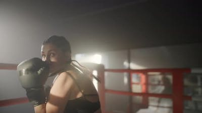 Woman Training Boxing in Boxing Ring