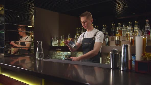 Thumbnail for Slow Motion, Bartender Plays with Cocktail Shakers at the Bar