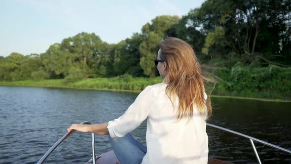 Cover Image for Beautiful Woman Sitting On Front Deck Of Boat