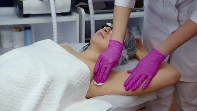 Armpit Disinfection Before Laser Hair Removal In A Beauty Salon. Body Care