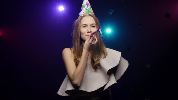 Thumbnail for Girl Blows Off Confetti with Palms, Blowing Party Whistle, Dancing