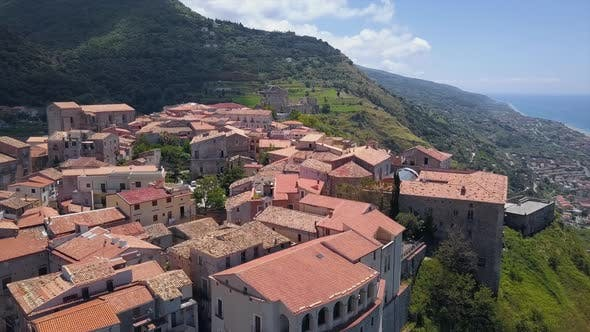 Cover Image for Aerial View of Medieval City on Hill Overlooking the Sea Coast Village and Mountains, Sunny Day