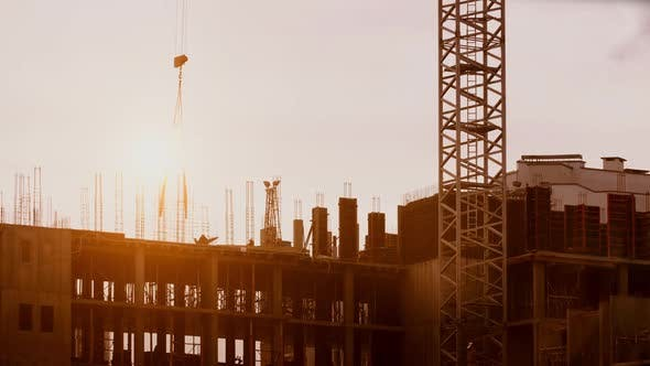 Cover Image for Crane Working on Construction Site Elevate Steel Weight, Constructors Working Sunny Evening