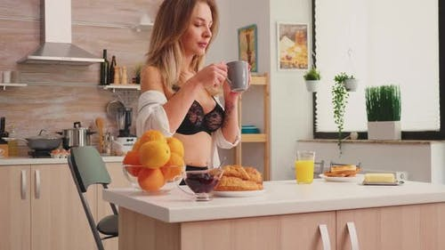 Sexy Lady Sipping Hot Coffee