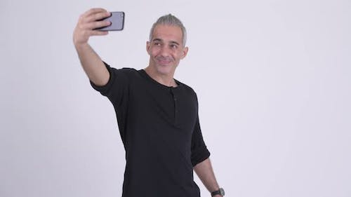 Happy Handsome Persian Man Taking Selfie with Phone