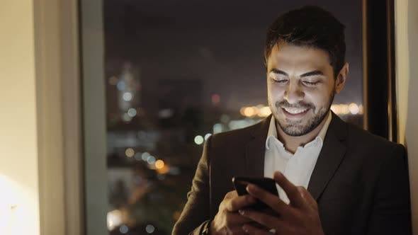 Thumbnail for Handsome Young Businessman Smiling After Sending a Voice Message using Smartphone App 5g
