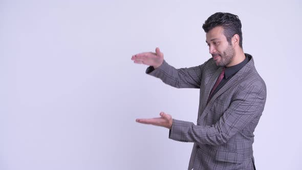 Thumbnail for Happy Bearded Persian Businessman Snapping Fingers and Looking Surprised