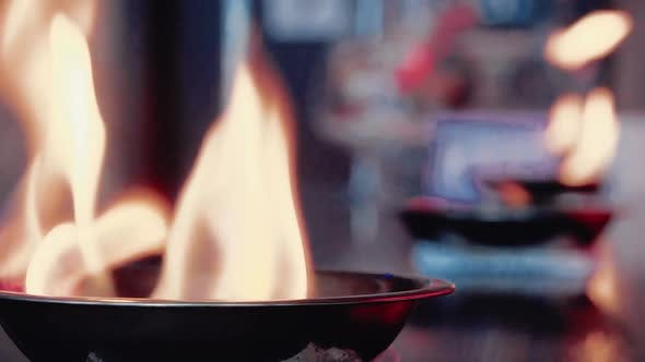 Fire Burns in the Plates on the Bar