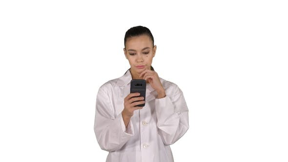 Thumbnail for Cheerful Cute Young Woman Doctor Typing Text on Phone While