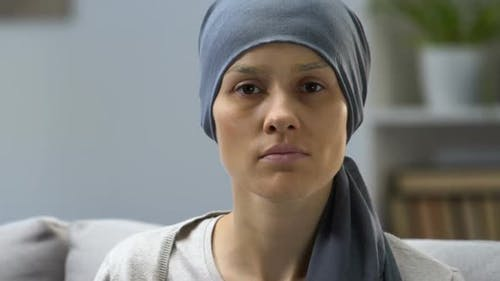 Portrait of Pale Woman Sick With Cancer