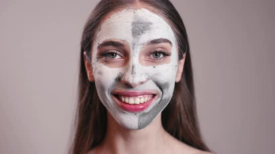 Thumbnail for Smiling Young Girl with Clay Mask on Face